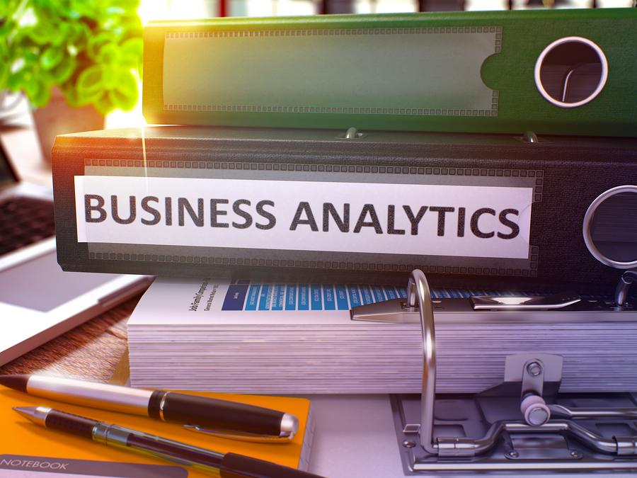 Marketing Analytics on Black Office Folder. Toned Image.